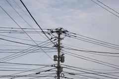 Detail of a utility pole and connecting cables Stock Photos