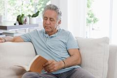 A senior man reading at home Stock Photos