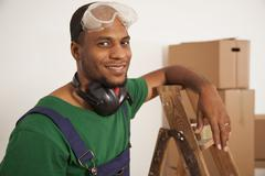Stock Photo of A man preparing to do some renovating, moving house