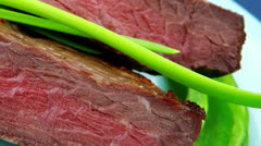 Meat savory : grilled beef fillet mignon on blue plate Stock Footage
