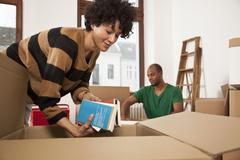 A couple packing moving boxes Stock Photos