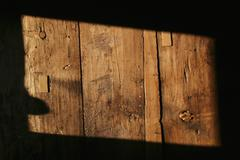 A rectangle shape of sunlight on a wooden structure, close-up Stock Photos
