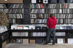 Rear view of young man in a record store - stock photo