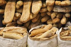 Heaps of fresh baked loafs of bread Stock Photos