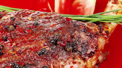 Red plate: grilled meat shoulder with tomato Stock Footage