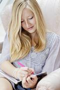 A teengirl writing in her diary Stock Photos