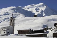 Church and villin mountains Stock Photos