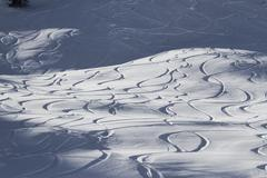 Abstract pattern of ski lines on slope Stock Photos
