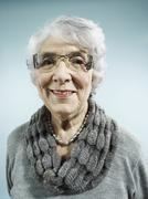 An elegant senior woman smiling at the camera - stock photo