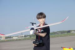 Boy with model airplane at the aband airfield at Tempelhof Airport, Berlin Stock Photos
