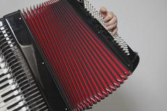 Detail of a man playing an accordion Stock Photos