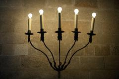 A sconce with illuminated electric candles - stock photo