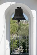 An old-fashioned bell hanging in an archway Stock Photos