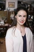 A woman standing in an antiques shop Stock Photos