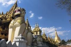 A lion statue in front of Shwedagon Pagoda, Yangon, Burma Stock Photos
