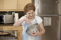 A senior woman mixing ingredients in a bowl Stock Photos
