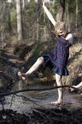 Girl kicking her feet through the water in Mooresville, North Carolina, USA Stock Photos