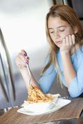 Girl unhappy with her spaghetti meal - stock photo