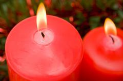 Red candles of christmas lit Stock Photos