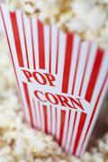 Detail of a red striped popcorn carton with Popcorn printed on it Stock Photos