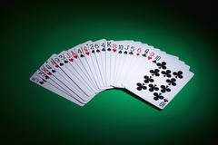 Cards fanned out on a gambling table Stock Photos