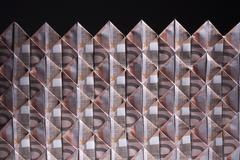 Ten Euro banknotes folded into diamond shapes and interwoven - stock photo