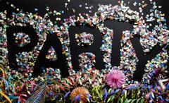 The word PARTY stenciled in confetti Stock Photos