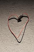 A red wire bent into the shape of heart Stock Photos