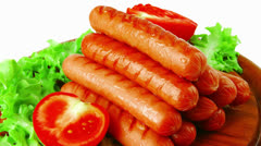 Beef red sausages on plate Stock Footage