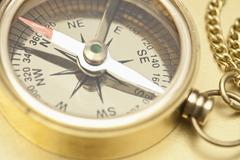 A brass pocket compass, close-up Stock Photos