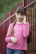 A girl using a mobile phone Stock Photos