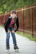 Portrait of a girl on rollerblades Stock Photos