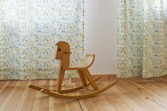 A rocking horse in a domestic room Stock Photos