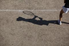 Shadow of tennis player Stock Photos