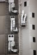 Anthropomorphic air vents on side of building - stock photo