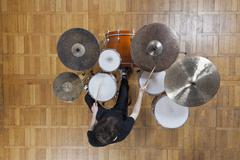 Drummer playing kit Stock Photos