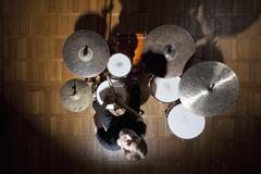 Drummer looks up - stock photo