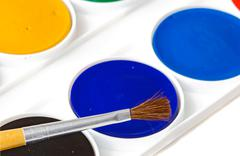 Box of watercolors with brush Stock Photos