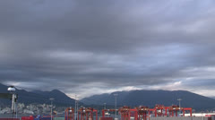 ALTOSTRATUS TIME LAPSE CLOUDS CONTAINER YARD MOUNTAINS Stock Footage