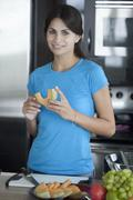 Woman preparing fruit in kitchen Stock Photos