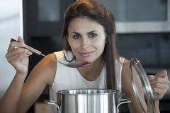 Elegant woman bring ladle to mouth Stock Photos