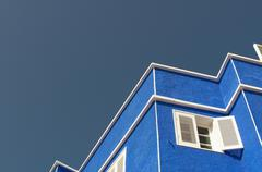 Zigzag pattern of outline of house against clear sky Stock Photos
