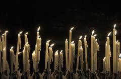 Flickering flames of candles Stock Photos