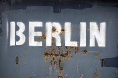 Berlin' stencil on metal container Stock Photos