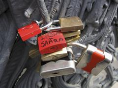 Lovelocks of passion on a bridge, attached by couples as a symbol their devotion Stock Photos