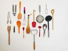 Stock Photo of Overhead shot of kitchen utensils which appear to be hanging