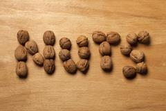 Single word 'nuts' spelled with walnuts - stock photo
