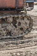 Rusted metal treads on a backhoe Stock Photos