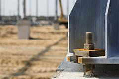 Large nut and bolt connected to beam in construction site Stock Photos