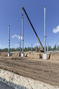 Crane and steel beams at construction site Stock Photos
